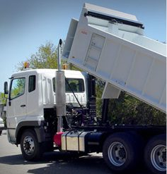White truck with loader