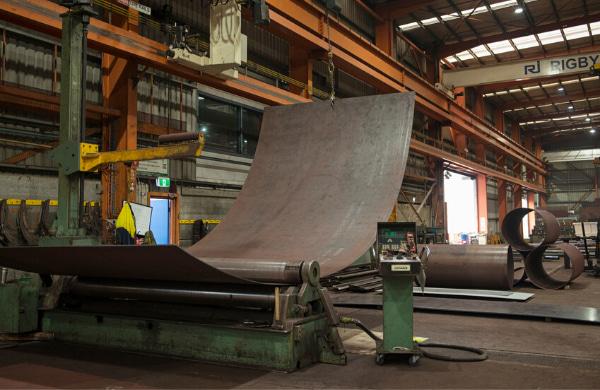 Old Steel presser machine inside a factory