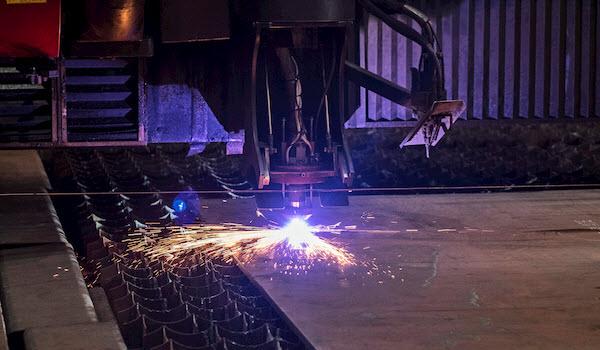 Plasma cutting machine inside a warehouse