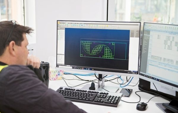 Man looking at the 3d design in computer