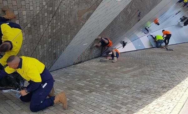 Men working on a metal steel design