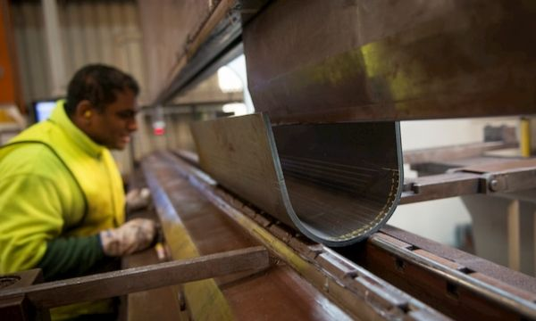 Man checking the machine for steel