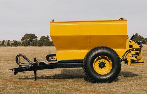 A yellow trailer at the backyard