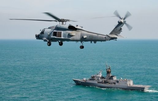 A helicopter and a ship