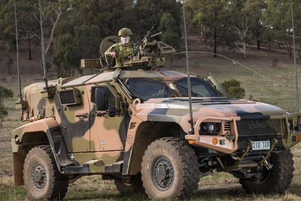 Military man riding a military car